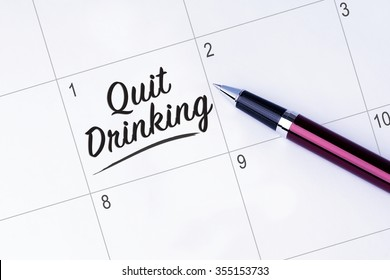 The words Quit Drinking on a calendar planner to remind you an important appointment with a pen on isolated white background. New Year concepts of goal and objective.