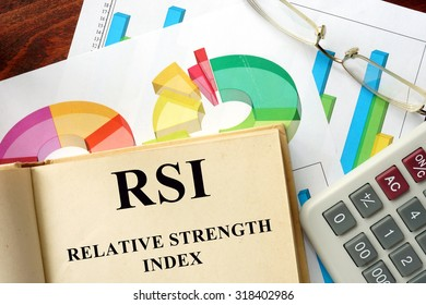 Words Relative Strength Index - RSI written on a book. Business concept.