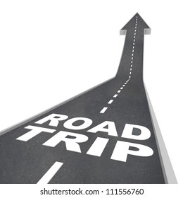 The words Road Trip on a street of blacktop pavement representing a fun adventure you will experience when traveling in ground transportation to your destination