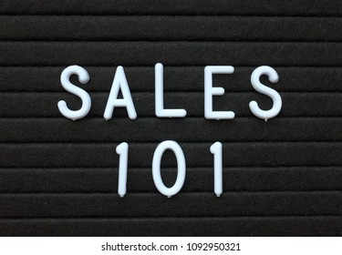 The words Sales 101 in white plastic letters on a black letter board as an introduction to the methods used to sell products and services