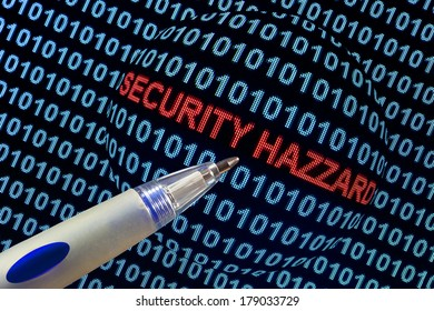 "The words ""security hazard"" in red binary code on computer monitor."