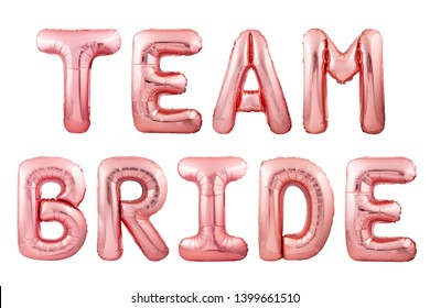 Words team bride made of rose gold inflatable balloon letters isolated on white background. Helium balloons forming words team bride. Wedding party balloons concept