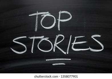 The words Top Stories written by hand in white chalk on a blackboard