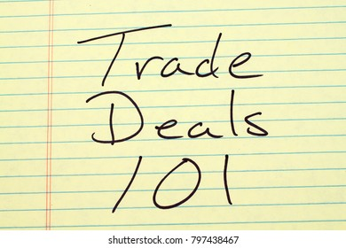 "The words ""Trade Deals 101"" on a yellow legal pad"