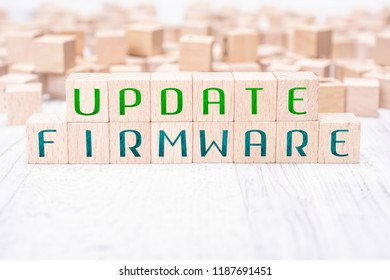 The Words Update Firmware Formed By Wooden Blocks On A White Table