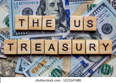 The words US Treasury on dollar usa background