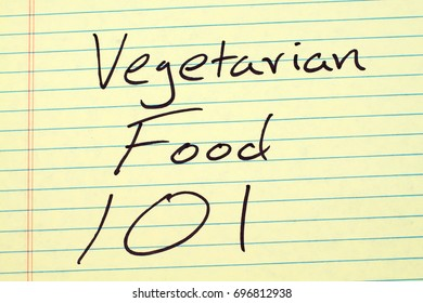 "The words ""Vegetarian Food 101"" on a yellow legal pad"