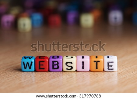 words website with dices on wooden table