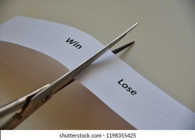"""words """"WIN or LOSE"""" on paper background"""