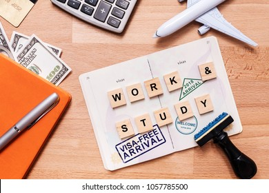 words work and study and visa free arrival stamp on foreign passport with airplane model. oversea travel , work and study in visa free arrival country concept