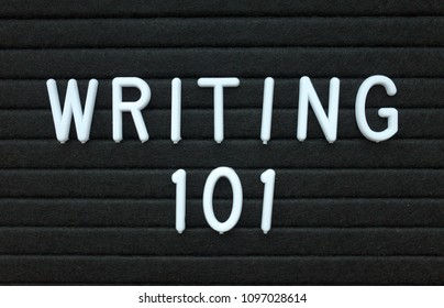 The words Writing 101 in white plastic letters on a black letter board as an introduction to writing skills for authors