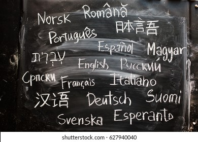 words written on chalkboard in different language: english, russian, hungarian, italian, finnish, german, esperanto, swedish, japanese, serbian, hebrew, portuguese, romanian, chinese, norwegian