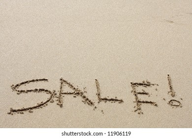 Words written in the sand on beach