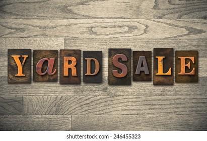 """The words """"YARD SALE"""" written in vintage wooden letterpress type."""