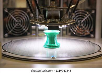 Work 3d printer. Printing 3D printer object green plastic. Plastic Wire Film, Modern printing technology. Progressive additive technology