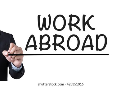 WORK ABROAD Businessman hand writing with black marker on white background