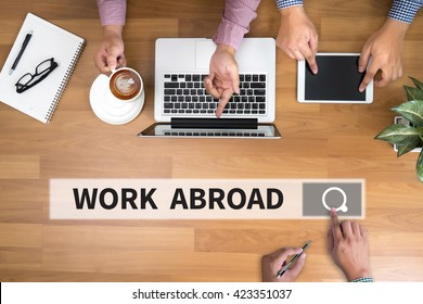 WORK ABROAD man touch bar search and Two Businessman working at office desk and using a digital touch screen tablet and use computer, top view