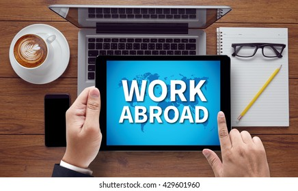 WORK ABROAD, on the tablet pc screen held by businessman hands - online, top view