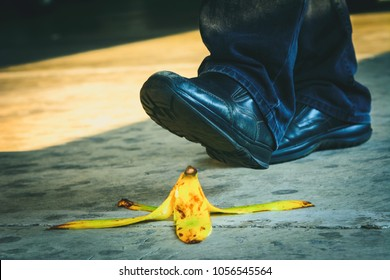 Work accident, a businessman stepping on banana skin peel.