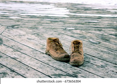 Work Boots on Wooden Deck