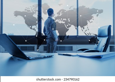 work desk of businessman with laptop, globalization business concept