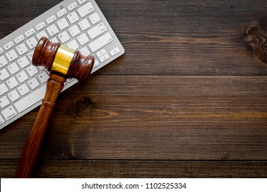 Work desk of contemporary lawyer. Lawyer office concept. Judge gavel near computer keyboard on dark wooden background top view space for text