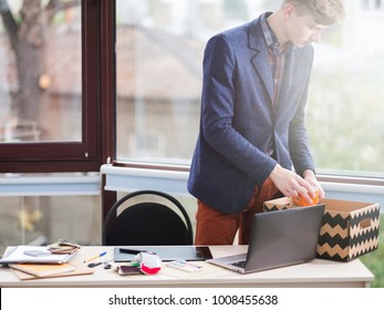 work dismissal. Redundancy. Job failure. Lost career. Young office worker puts his stuff in a box