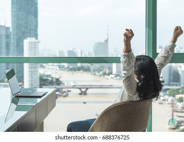 Work done, life balance and success celebration concept with happy woman take it easy casually resting in luxury business hotel or at home office workplace with computer pc laptop on desk