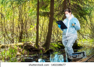 the work of the ecologist in the natural environment, the study of the composition of water from the forest lake