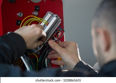 Work of electrician engineer - switching and testing equipment with wires