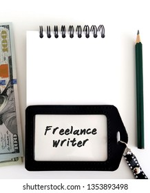 Work equipment - notebook/pencil/cash dollars money /an ID card with written text FREELANCE WRITER , all on white background. Concept of self-employed /independent job of freelance writing.
