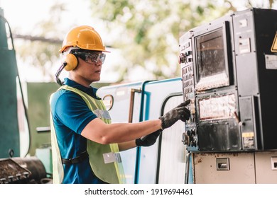 Work at factory.Asian worker man  working in safety work wear with yellow helmet using digital tablet .in factory workshop industry machine professional