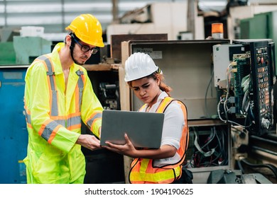 Work at factory.engineer and workers team working together in safety jumpsuit uniform with white and yellow helmet using laptop computer.in factory workshop industry concept professional