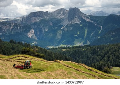 Work in the fields in the beautiful environment of Val Gardena