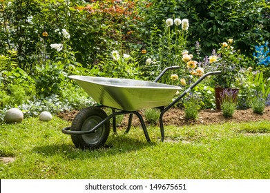 Work in garden-wheelbarrow on the front of flower bed