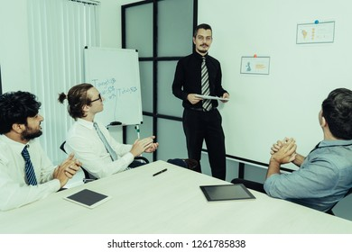 Work group approving training and applauding speaker. Boss presenting high business results and promising to give team raise. Presentation, successful training, praise concept
