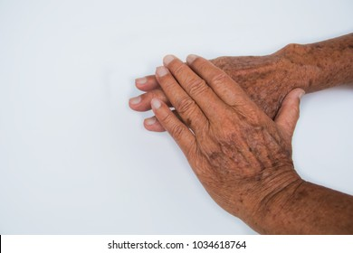 The work hard of old man hands hold together on isolated background, it is mentally thought for his future and his illness, his skin very wrinkle