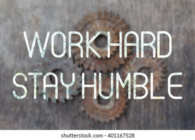 Work Hard Stay Humble quote on blurred old Cutting blades background.