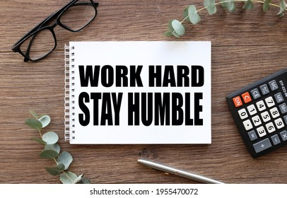 Work Hard Stay Humble. text on white paper on wood table background