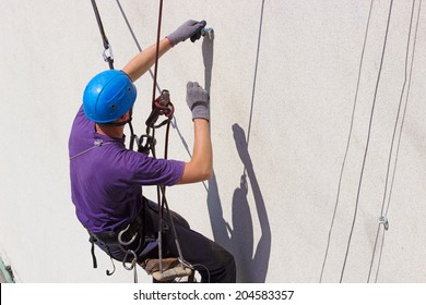 Work at height  ; Specially equipped worker performs height work,photography