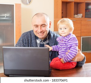 Work at home. Adult father and baby daughter