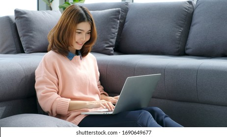 Work from home, Asian woman working with laptop computer at home office, Asia female shopping online, Happy girl learning by internet, study online education, e commerce business, people technology