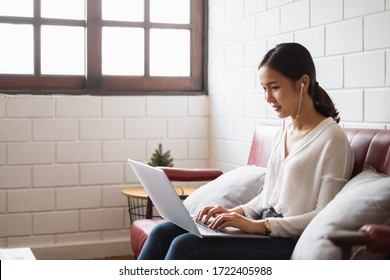 Work from home or work at home concept, asian woman working with laptop computer at home