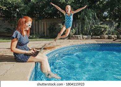 Work from home with kids children. Mother working on laptop by swimming pool. Child daughter jumping in water. Funny family moment. New normal workation at coronavirus quarantine.
