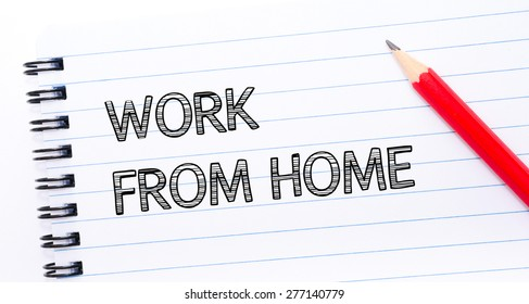 WORK FROM HOME  written on notebook page, red pencil on the right. Concept image