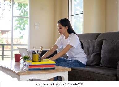 Work from home.Asian woman works at her home. - Shutterstock ID 1722746236