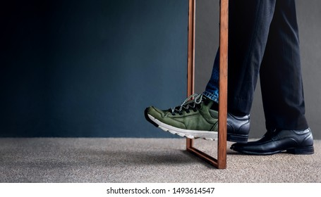 Work Life Balance Concept. Challenging to Change. Low Section of Businessman Steps passing a wooden frame. Half is a Formal Dress and other side is a Casual Traveling Shoes