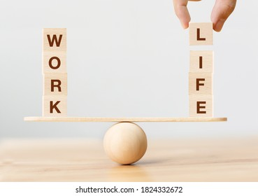 Work life balance concept. Wooden cube block with word WORK and LIFE on seesaw