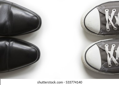Work Life Balance. An elegant business shoe  and a casual shoe facing each other.