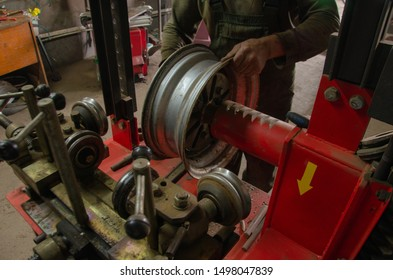 work of the master with tire fitting equipment